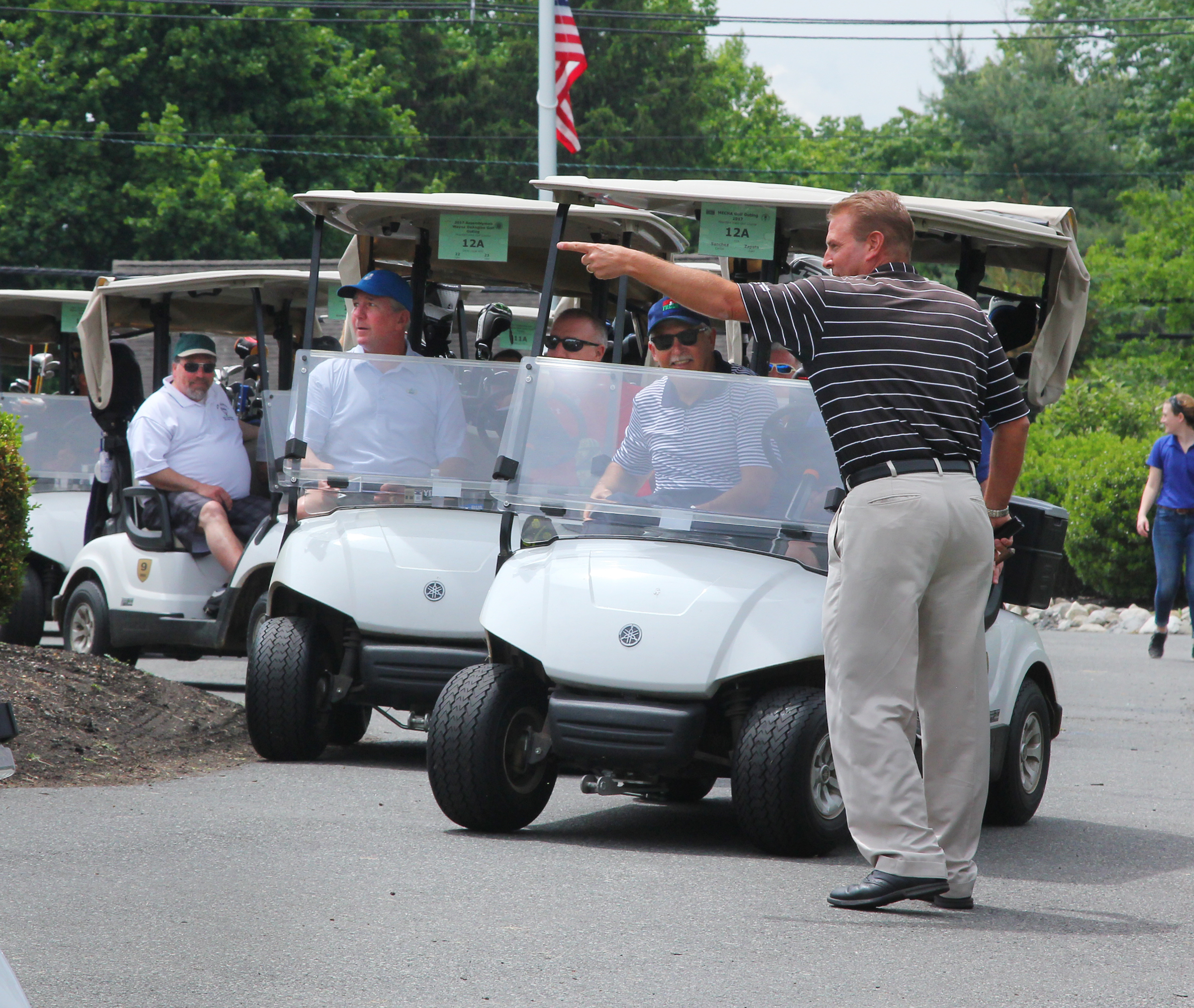 Wayne P. DeAngelo Golf Outing, May 24, 2017, Mountain View Golf Club. Very anxious and almost comical golfers race to their tees to start the outing as John Kostin, Mercer County Director of Golf Operations, points the way to the front nine
