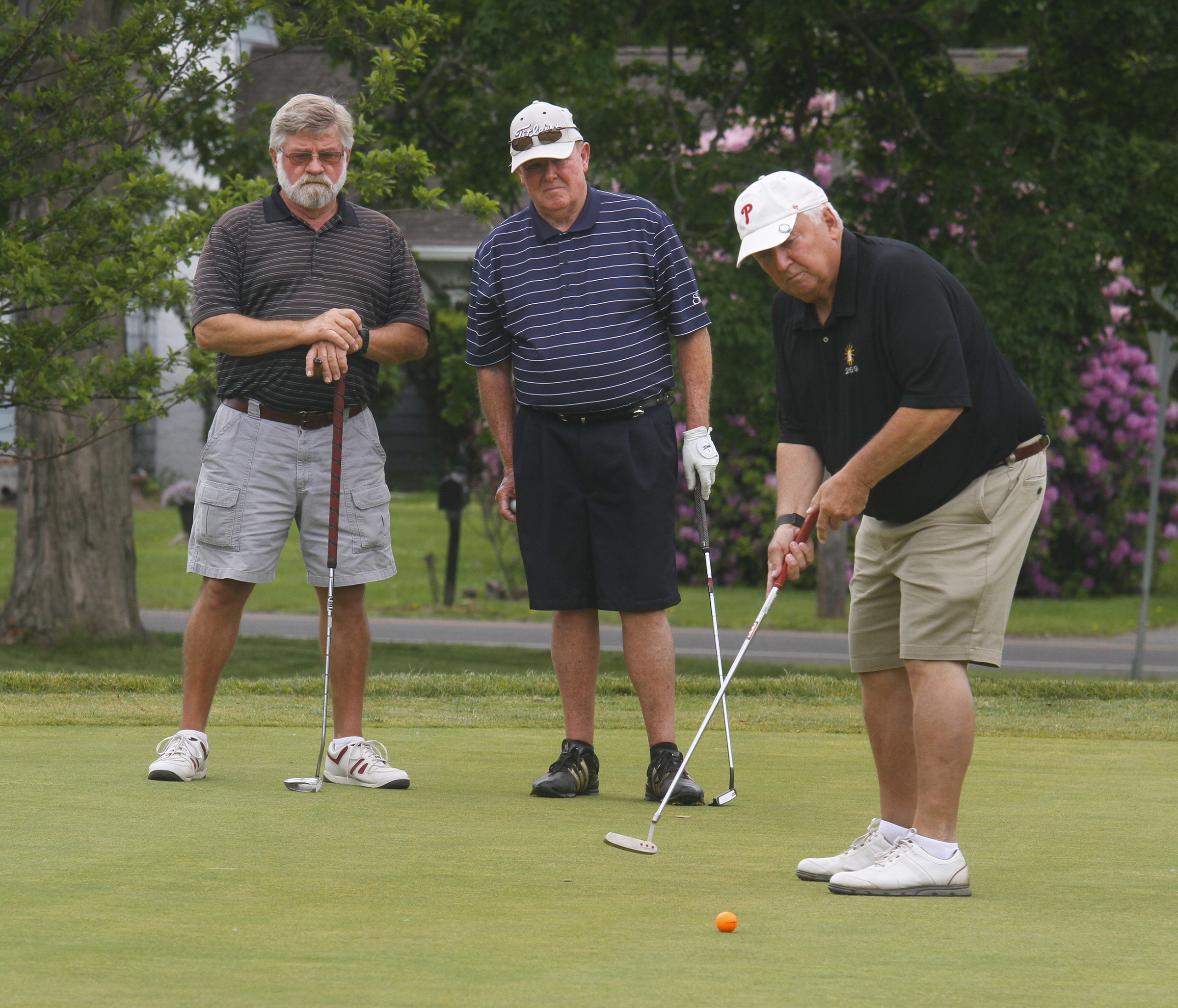 Wayne P. DeAngelo Golf Outing, May 24, 2017, Mountain View Golf Club. IBEW local 269 (Trenton) L-R, Sunny Canimore and Tom Bates Jr watch Tom O'Connor putt.
